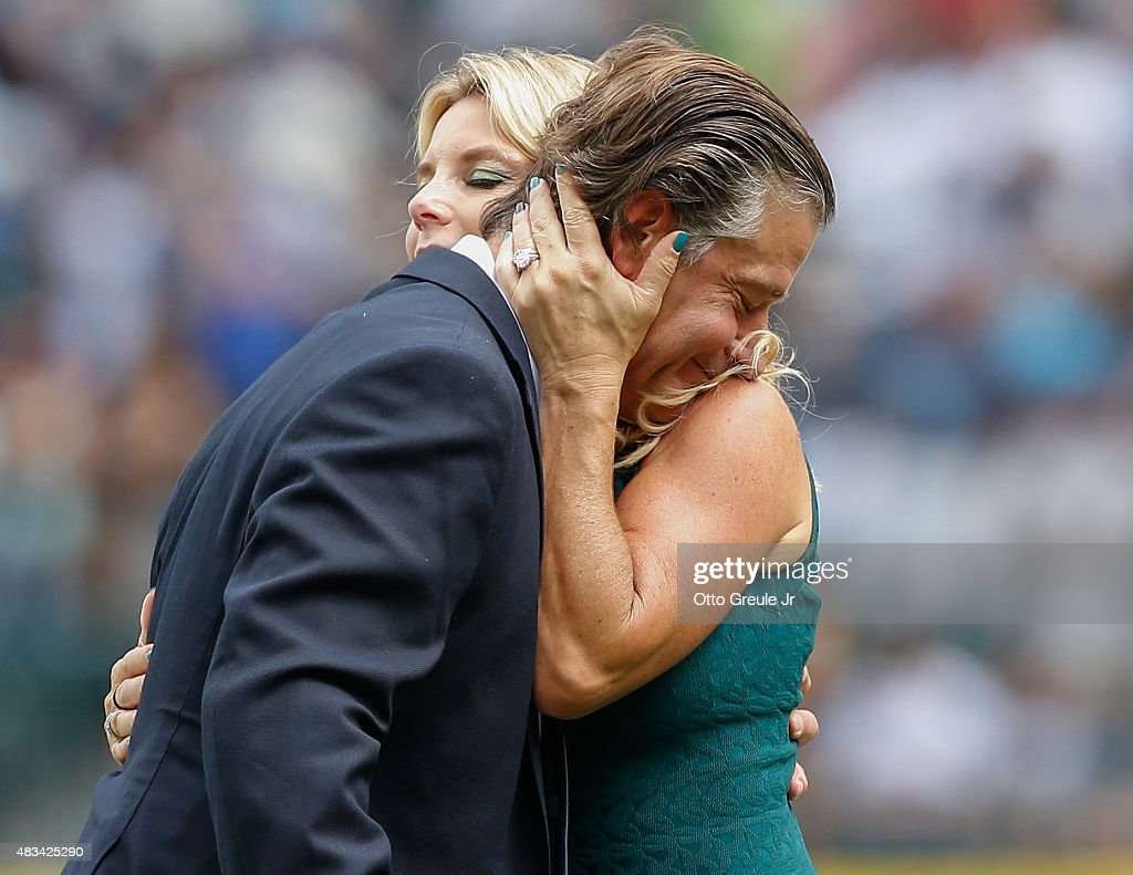 Former Seattle Mariners pitcher Jamie Moyer gets a hug from his wife Karen during ceremonies inducting him into the Seattle Mariners' Hall of Fame prior to the game against the Texas Rangers at Safeco Field on August 8, 2015 in Seattle, Washington.