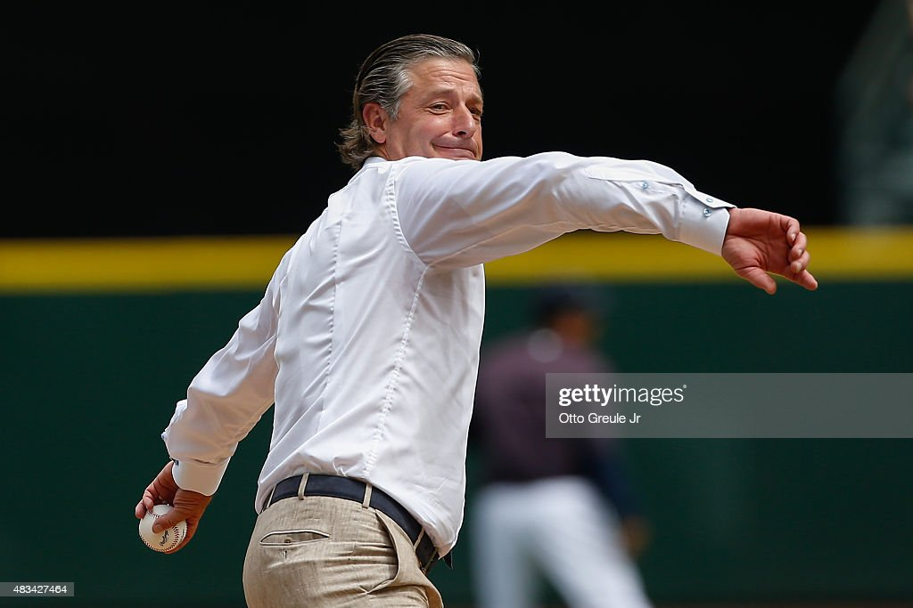 Former Seattle Mariners pitcher Jamie Moyer throws out the ceremonial first pitch following ceremonies inducting him into the Seattle Mariners' Hall of Fame prior to the game against the Texas Rangers at Safeco Field on August 8, 2015 in Seattle, Washington.