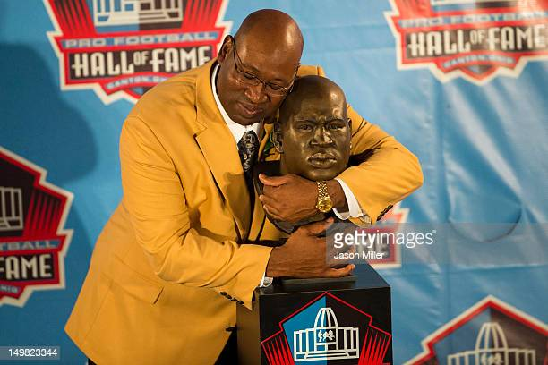 Former Seattle Seahawks defensive tackle Cortez Kennedy with his bust during the Class of 2012 Pro Football Hall of Fame Enshrinement Ceremony at...