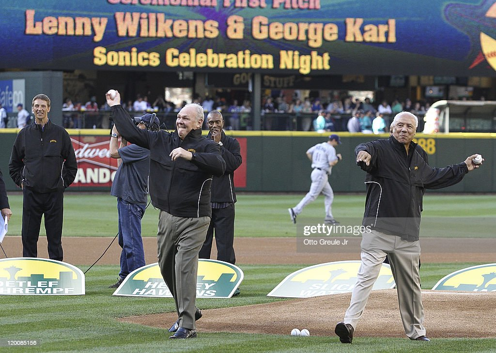 Former Seattle SuperSonics coaches Lenny Wilkens (R) and George Karl throw out the ceremonial first pitch as part of 'Sonics Celebration Night' prior to the game between the Seattle Mariners and the Tampa Bay Rays at Safeco Field on July 29, 2011 in Seattle, Washington.