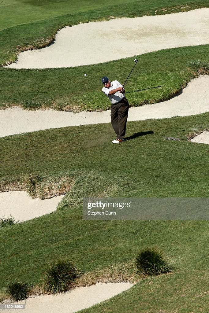 Former Secretary of Defense Leon Panetta hits from the rough on the sixth hole durng the first round of the Nature Valley First Tee Open at Pebble Beach at Pebble each Golf Links on September 27, 2013 in Pebble Beach, California.