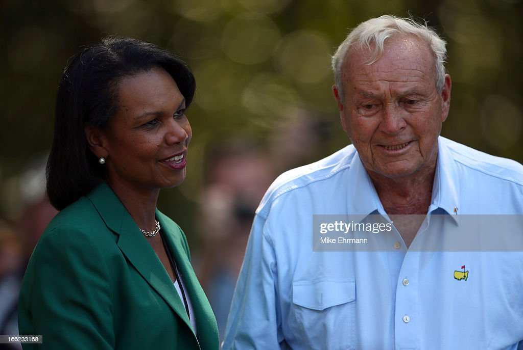 Former Secretary of State and Augusta National Golf Club member, <a gi-track='captionPersonalityLinkClicked' href=/galleries/search?phrase=Condoleezza+Rice&family=editorial&specificpeople=157540 ng-click='$event.stopPropagation()'>Condoleezza Rice</a>, talks with <a gi-track='captionPersonalityLinkClicked' href=/galleries/search?phrase=Arnold+Palmer&family=editorial&specificpeople=93096 ng-click='$event.stopPropagation()'>Arnold Palmer</a> of the United States during the Par 3 Contest prior to the start of the 2013 Masters Tournament at Augusta National Golf Club on April 10, 2013 in Augusta, Georgia.
