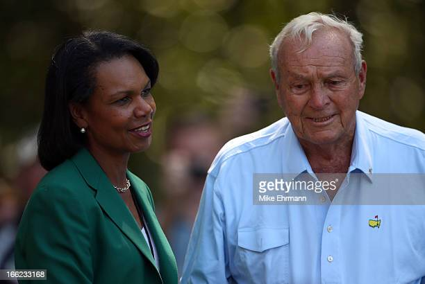 Former Secretary of State and Augusta National Golf Club member Condoleezza Rice talks with Arnold Palmer of the United States during the Par 3...
