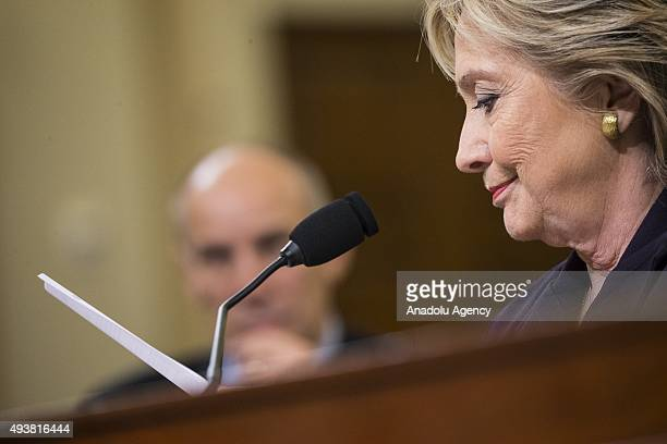 Former Secretary of State and Democratic Presidential Candidate Hillary Clinton reads a piece of evidence while testifying in front of the Benghazi...