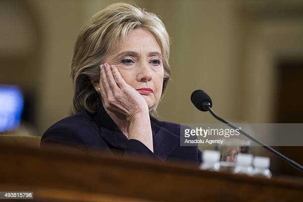 Former Secretary of State and Democratic Presidential Candidate Hillary Clinton looks at a piece of evidence on a monitor while testifying in front...