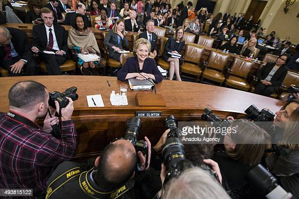 Former Secretary of State and Democratic Presidential Candidate Hillary Clinton takes her seat before the third round of questions from the Benghazi...