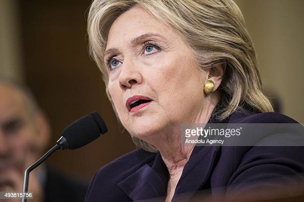 Former Secretary of State and Democratic Presidential Candidate Hillary Clinton listens to questions from committee members while testifying in front...