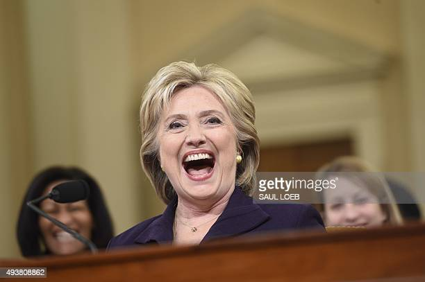 Former Secretary of State and Democratic Presidential hopeful Hillary Clinton laughs during testimony before the House Select Committee on Benghazi...