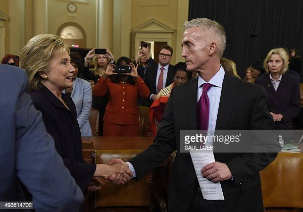 Former Secretary of State and Democratic Presidential hopeful Hillary Clinton shakes hands with Republican US Representative from South Carolina Trey...