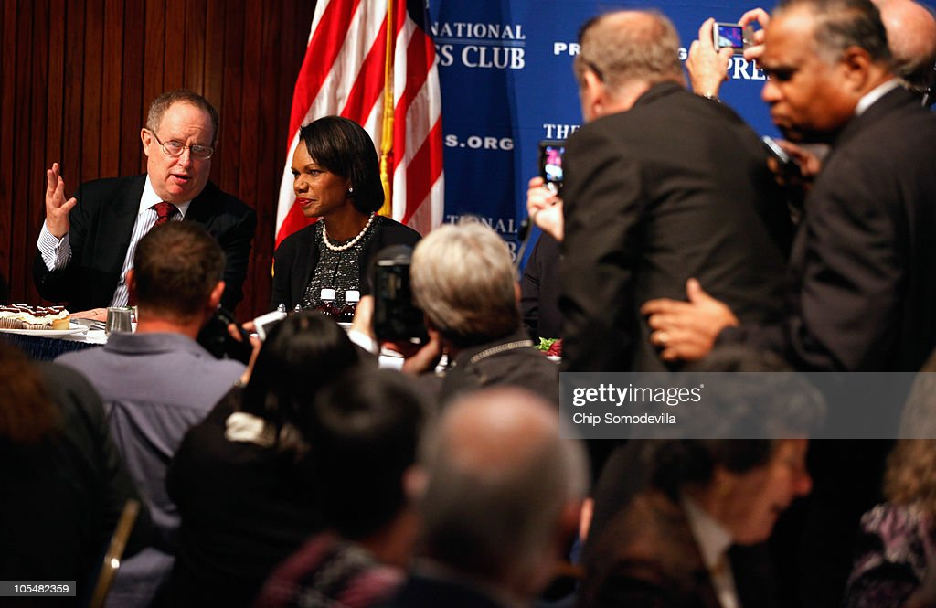 Former Secretary of State <a gi-track='captionPersonalityLinkClicked' href=/galleries/search?phrase=Condoleezza+Rice&family=editorial&specificpeople=157540 ng-click='$event.stopPropagation()'>Condoleezza Rice</a> (2L) visits with George Washington University adjunct professor Myron Belkind (L) before talking about her new book, 'Extraordinary, Ordinary People: A Memoir of Family,' during the Newsmakers luncheon at the National Press Club October 15, 2010 in Washington, DC. The book is about Rice's family and growing up in racially-segregated Birmingham, Alabama, during the 1950s and 60s.