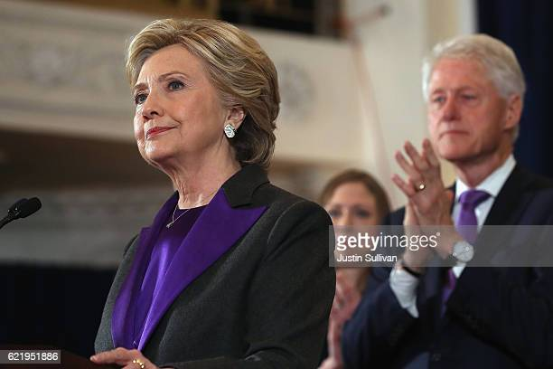 Former Secretary of State Hillary Clinton accompanied by her husband former President Bill Clinton concedes the presidential election at the New...