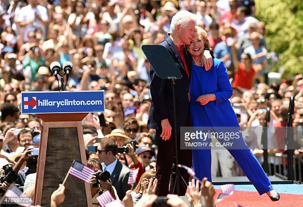 Former Secretary of State Hillary Clinton and Former US President Bill Clinton hug after she officially launched her campaign for the Democratic...