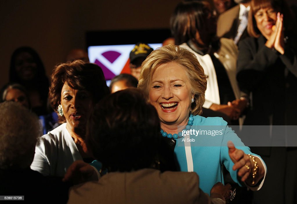 Former Secretary of State Hillary Clinton greets key local African American leaders for a photo opportunity before speaking to people at the California African American Museum during a morning campaign stop with Los Angeles Community leaders on Thursday, May 5, 2016 in Los Angeles, California.