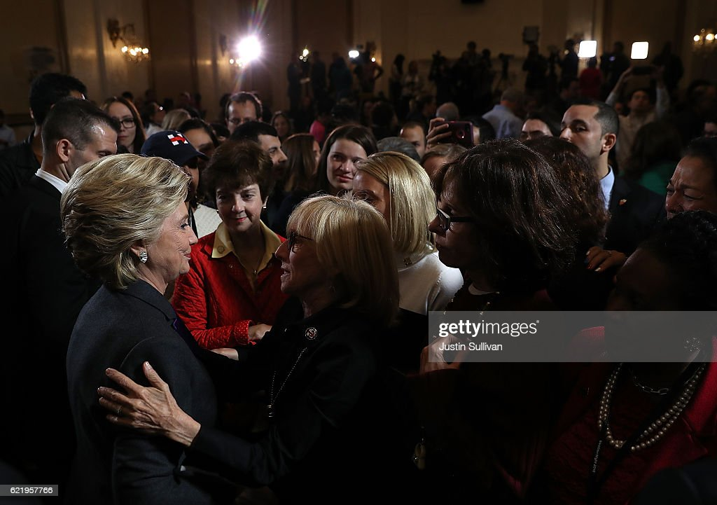 Former Secretary of State Hillary Clinton greets supporters and members of her staff during a news conference at the New Yorker Hotel on November 9, 2016 in New York City. Hillary Clinton conceded the U.S. Presidency to Republican challenger Donald Trump.