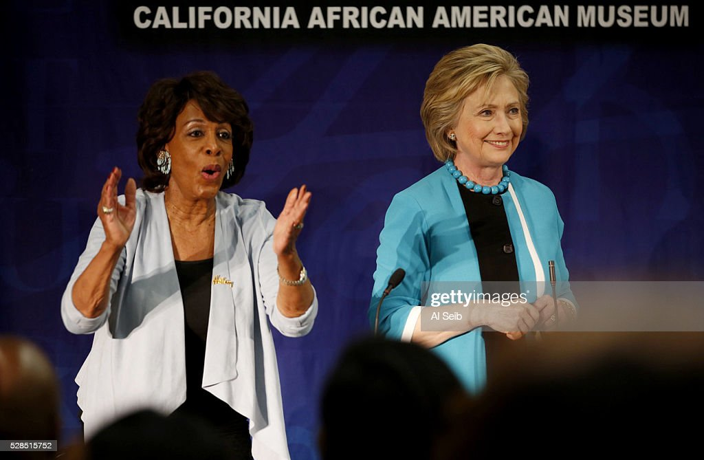 Former Secretary of State Hillary Clinton is applauded by congressional Representative Maxine Waters, left, as she talks with key local African American leaders at the California African American Museum during a morning campaign stop with Los Angeles Community leaders on Thursday, May 5, 2016 in Los Angeles, California.