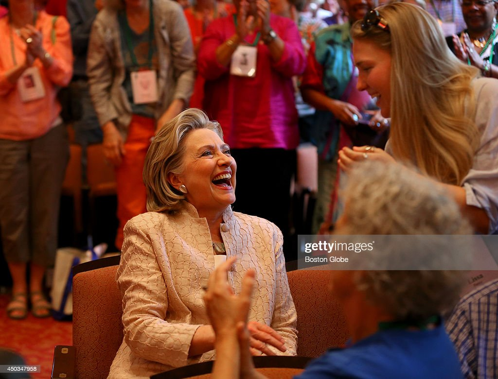 Former Secretary of State Hillary Clinton, middle, receives a round of applause from the audience after being introduced by former Secretary of State Madeline Albright at Wellesley College.