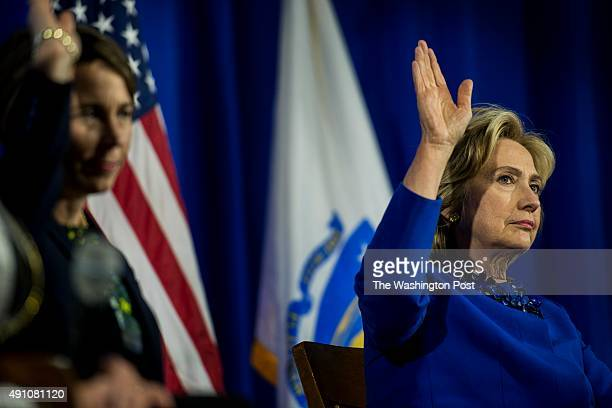 Former Secretary of State Hillary Clinton raises her hand during a community forum on substance abuse at Boston Teachers Union Local 66 in Dorchester...