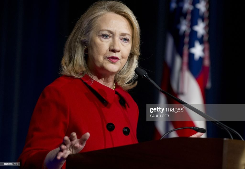 Former Secretary of State Hillary Clinton speaks after receiving awards from Secretary of Defense Leon Panetta and Chairman of the Joint Chiefs Martin Dempsey during a ceremony at the Pentagon in Washington, DC, February 14, 2013. AFP PHOTO / Saul LOEB