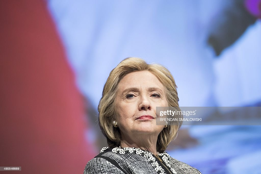 Former Secretary of State Hillary Clinton waits to speak at the World Bank May 14, 2014 in Washington, DC. Clinton and World Bank President Jim Yong Kim joined others to speak about women's rights. AFP PHOTO/Brendan SMIALOWSKI