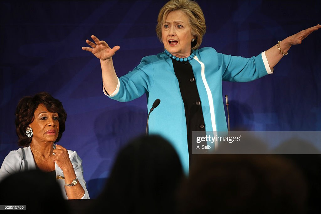 Former Secretary of State Hillary Clinton with congressional Representative Maxine Waters, left, talks with key local African American leaders at the California African American Museum during a morning campaign stop with Los Angeles Community leaders on Thursday, May 5, 2016 in Los Angeles, California.