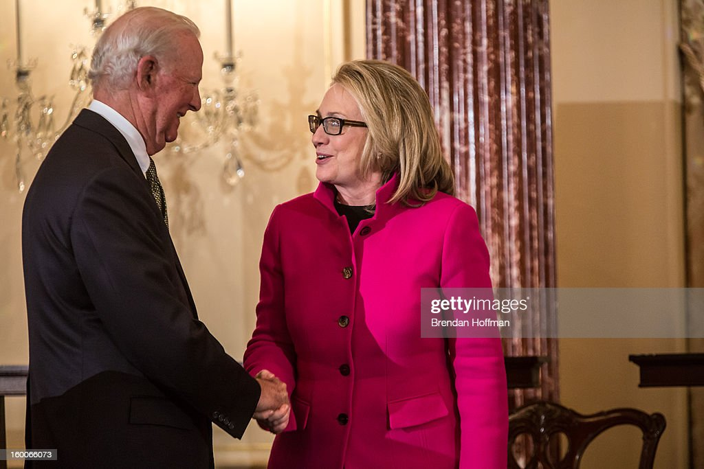 Former Secretary of State James Baker (L) shakes hands with Secretary of State <a gi-track='captionPersonalityLinkClicked' href=/galleries/search?phrase=Hillary+Clinton&family=editorial&specificpeople=76480 ng-click='$event.stopPropagation()'>Hillary Clinton</a> at an event launching the Diplomacy Center on January 25, 2013 in Washington, DC. The center will serve as a museum of diplomacy, housed at the Department of State.