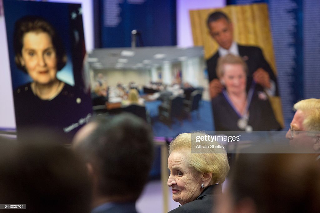 Former Secretary of State <a gi-track='captionPersonalityLinkClicked' href=/galleries/search?phrase=Madeleine+Albright&family=editorial&specificpeople=211429 ng-click='$event.stopPropagation()'>Madeleine Albright</a> sits before a backdrop of enlarged photos of her during a ceremony in which she was presented with the Department of Defense Medal for Distinguished Public Service by Secretary of Defense Ash Carter, on June 30, 2016 at the Pentagon in Arlington, Virginia.