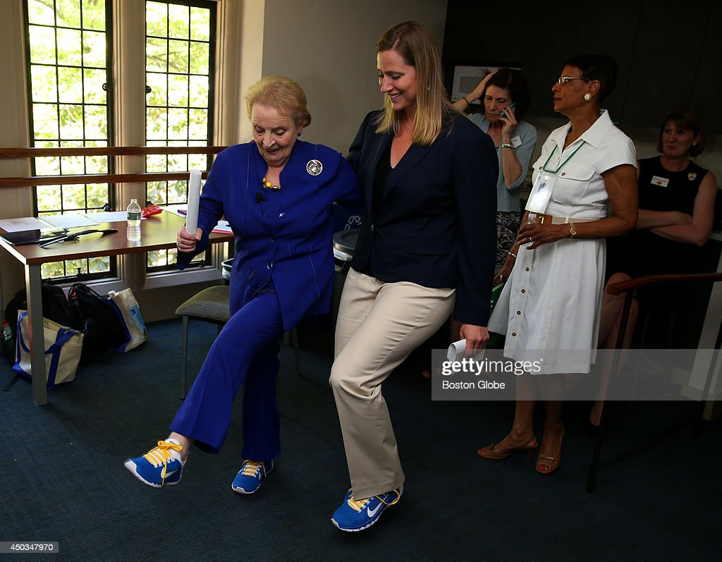 Former Secretary of State Madeline Albright, left, and Olympian Angela Ruggiero, right, were on hand at Wellesley College during Alumni Weekend. Albright, was showing off her sneakers before speaking to an audience.