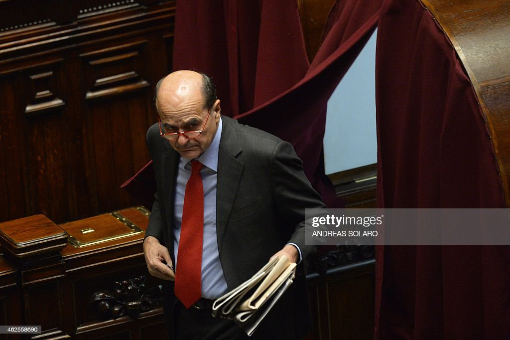 Former secretary of the Italian Democratic party Pierluigi Bersani leaves a voting booth to cast his ballot on January 31 2015 at the Italian...