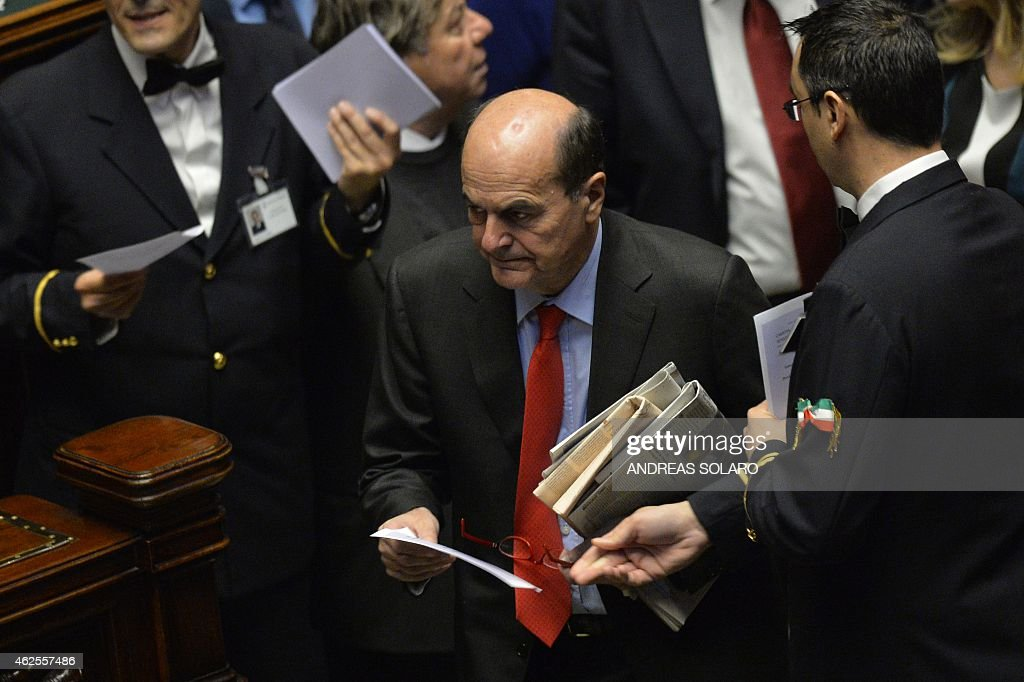 Former secretary of the Italian Democratic party (PD) <a gi-track='captionPersonalityLinkClicked' href=/galleries/search?phrase=Pierluigi+Bersani&family=editorial&specificpeople=4182508 ng-click='$event.stopPropagation()'>Pierluigi Bersani</a>, prepares to vote on January 31, 2015 at the Italian Parliament in Rome during the fourth round for the election of a new President, after Giorgio Napolitano resigned on January 14. Italian Prime Minister Matteo Renzi backed a little-known Constitutional Court judge, whose brother was slain by the mafia, to be Italy's next president. White-haired Sicilian Sergio Mattarella, 73, will be supported by Renzi's ruling Democratic Party in a multi-round election to produce a successor to the recently retired Giorgio Napolitano on January 31, the premier said ahead of an inconclusive first vote. AFP PHOTO / ANDREAS SOLARO