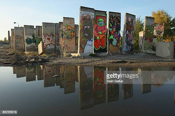 Former sections of the Berlin Wall are reflcted in a puddle on a sunny fall day on October 11 2008 in Teltow just outside Berlin Germany Germany...