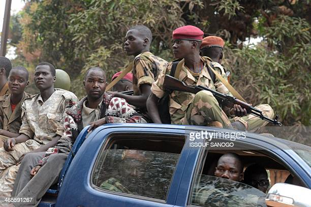 Former Seleka militants are escorted by French troops of the Sangaris operation and Rwanda's MISCA peacekeepers out of Kasai military camp in Bangui...