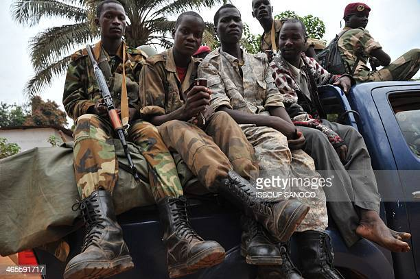 Former Seleka rebels are escorted by French troops of the Sangaris Operation and Rwandan MISCA peacekeepers out of the Kassai military camp in Bangui...