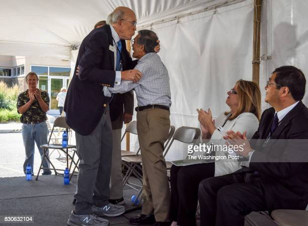 Former Sen Alan Simpson left kisses former Sec Norman Mineta on the forehead during ceremonies for the 75th anniversary of Heart Mountain Japanese...