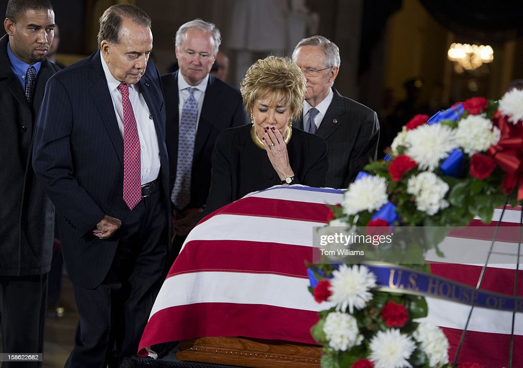 Former Sen. Bob Dole, R-Kan., and his wife former Sen. Elizabeth Dole, R-N.C., visit the casket of the late Sen. Daniel Inouye, D-Hawaii, as his body lies in state in the Capitol rotunda. Bob Dole and Inouye knew each other since they were recovering from World War II battle wounds. Dole was assisted to the casket saying 'I wouldn't want Danny to see me in a wheelchair.'