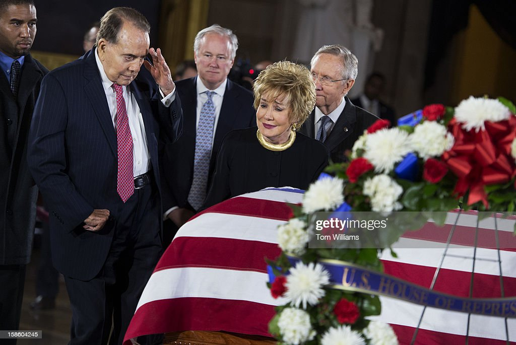 Former Sen. Bob Dole, R-Kan., salutes the casket of the late Sen. Daniel Inouye, D-Hawaii, as his body lies in state in the Capitol rotunda, as Dole's wife, former Sen. Elizabeth Dole, R-N.C., looks on. Bob Dole and Inouye knew each other since they were recovering from World War II battle wounds. Dole was assisted to the casket saying 'I wouldn't want Danny to see me in a wheelchair.'