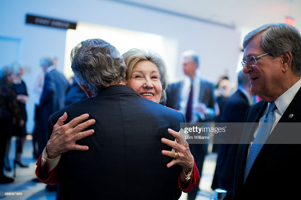 Former Sen. <a gi-track='captionPersonalityLinkClicked' href=/galleries/search?phrase=Kay+Bailey+Hutchison&family=editorial&specificpeople=218057 ng-click='$event.stopPropagation()'>Kay Bailey Hutchison</a>, R-Texas, hugs former Sen. <a gi-track='captionPersonalityLinkClicked' href=/galleries/search?phrase=Tom+Daschle&family=editorial&specificpeople=201758 ng-click='$event.stopPropagation()'>Tom Daschle</a>, D-S.D., as former Sen. <a gi-track='captionPersonalityLinkClicked' href=/galleries/search?phrase=Trent+Lott&family=editorial&specificpeople=202663 ng-click='$event.stopPropagation()'>Trent Lott</a>, R-Miss., looks on during a gala that was part of the dedication ceremony for the Edward M. Kennedy Institute in Boston, Mass., March 29, 2015.