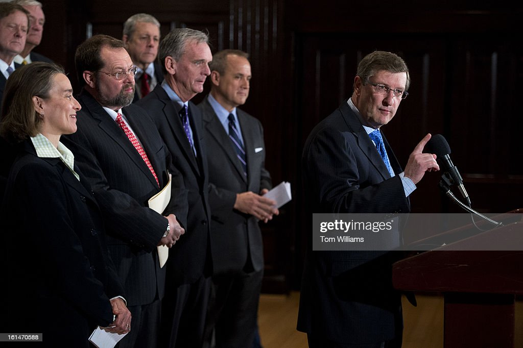 Former Sen. Kent Conrad, D-N.D., makes remarks during a news conference at the National Press Club with the Campaign to Fix the Debt to outline a new report from the Committee for a Responsible Federal Budget entitled 'Our Debt Problems are Far From Solved.' Also appearing from left are, former Sen. Blanche Lincoln, D-Ark., former Rep. Steve LaTourette, R-Ohio, former Sen. Judd Gregg, R-N.H., and former Rep. Jim Nussle, R-Iowa.