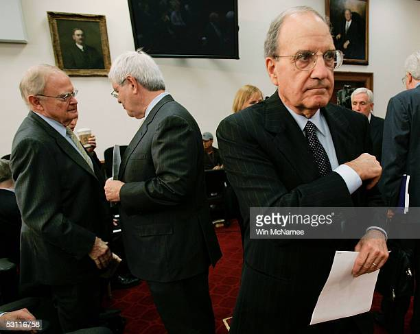 Former Senate Majority Leader George Mitchell prepares for the start of a hearing on reforming the United Nations while former Speaker of the House...