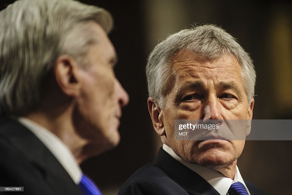 Former Senator Chuck Hagel (R-NE) looks on as former Senator John Warner Nunn (R-VA) makes his introductory speech to the Senate Armed Services Committee on Hagel's nomination to become secretary of defense, Thursday, January 31, 2013.