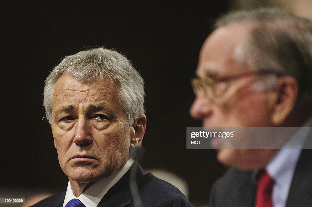 Former Senator Chuck Hagel (R-NE) looks on as former Senator Sam Nunn (D-GA) makes his introductory speech to the Senate Armed Services Committee on Hagel's nomination to become secretary of defense, Thursday, January 31, 2013.
