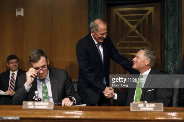 Former Senator Dan Coats director of National Intelligence nominee for US President Donald Trump center greets Senator Richard Burr a Republican from...
