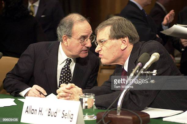Former Senator George Mitchell left and Commissioner of Baseball Allan H 'Bud' Selig talk before a Senate Hearing discussing the revenue gap between...