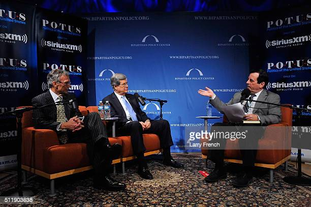 Former senators Tom Daschle left and Trent Lott center discuss their new book Crisis Point at SiriusXMBipartisan Policy Center's event hosted by...