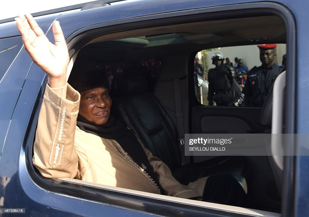 Former Senegalese president <a gi-track='captionPersonalityLinkClicked' href=/galleries/search?phrase=Abdoulaye+Wade&family=editorial&specificpeople=209316 ng-click='$event.stopPropagation()'>Abdoulaye Wade</a> (L) waves as he arrives at the courthouse in Dakar on March 23, 2015, ahead of the sentencing of his son following his trial involving corruption charges. Karim Wade, the flamboyant son of Senegal's former president <a gi-track='captionPersonalityLinkClicked' href=/galleries/search?phrase=Abdoulaye+Wade&family=editorial&specificpeople=209316 ng-click='$event.stopPropagation()'>Abdoulaye Wade</a>, was sentenced to six years in jail in a graft case that has gripped the nation. The presidential hopeful and former minister was found guilty of 'illicit enrichment' and also fined the equivalent of more than 210 million euros ($230 million) but was cleared of the main corruption charge.