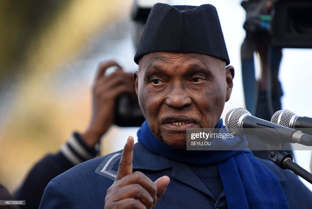 Former Senegal's president <a gi-track='captionPersonalityLinkClicked' href=/galleries/search?phrase=Abdoulaye+Wade&family=editorial&specificpeople=209316 ng-click='$event.stopPropagation()'>Abdoulaye Wade</a> gestures as he speaks during a meeting of the opposition Senegalese Democratic Party (Parti Democratique Senegalais, PDS) on February 4, 2015 at the Place de l'Obelisque in Dakar.