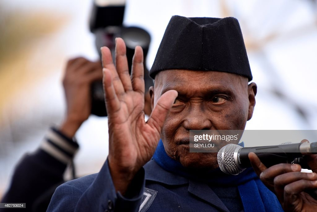 Former Senegal's president <a gi-track='captionPersonalityLinkClicked' href=/galleries/search?phrase=Abdoulaye+Wade&family=editorial&specificpeople=209316 ng-click='$event.stopPropagation()'>Abdoulaye Wade</a> waves to the crowd as he speaks during a meeting of the opposition Senegalese Democratic Party (Parti Democratique Senegalais, PDS) on February 4, 2015 at the Place de l'Obelisque in Dakar.