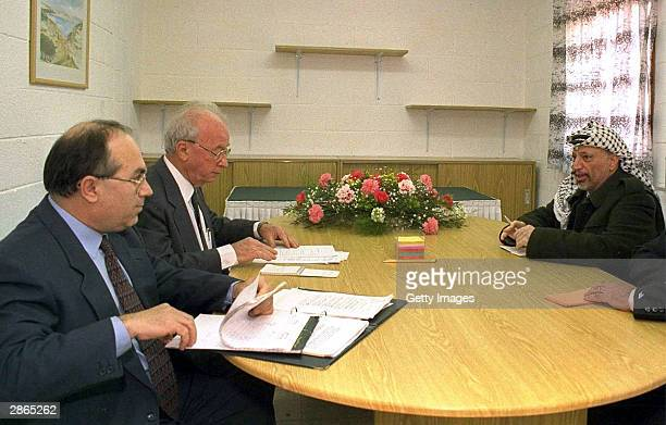 Former senior Shin Bet official Yossi Ginossar sits in on a meeting between the late Israeli Prime Minister Yitzhak Rabin and Palestinian leader...