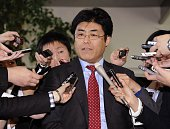 Former Seoul bureau chief of Japan's conservative Sankei Shimbun newspaper Tatsuya Kato is surrounded by reporters after he met with Japanese Prime...