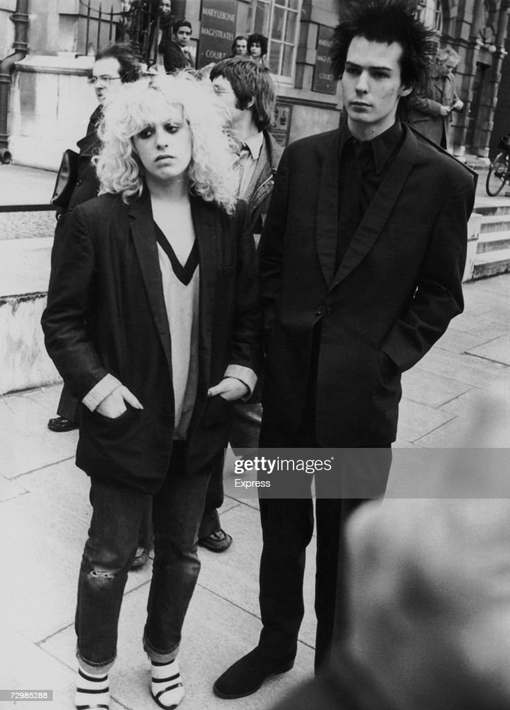 Former Sex Pistols bassist Sid Vicious (John Simon Ritchie, 1957 - 1979) with his girlfriend Nancy Spungen (1958 - 1978) outside Marylebone Magistrates Court, London, 1978.