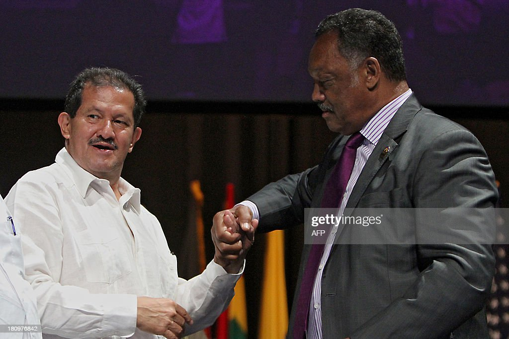 US former Shadow Senator of the District Columbia and Human Rights activist, Jesse Jackson (R), greets Colombian Vice-President Angelino Garzon during the closing ceremony of the 3rd Global Summit of Mayors and Governors of African descent at the Julio Cesar Turbay Convention Center in Cartagena, Colombia on September 18, 2013. AFP PHOTO/Joaquin Sarmiento